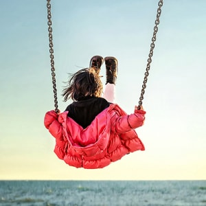 Wrap products benefit stock photo little girl on the swing