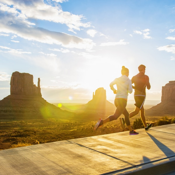 Px photo id caucasian couple running in monument valley utah united states