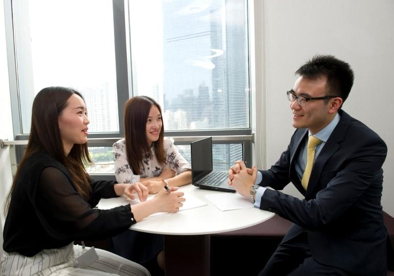employees having meeting around table