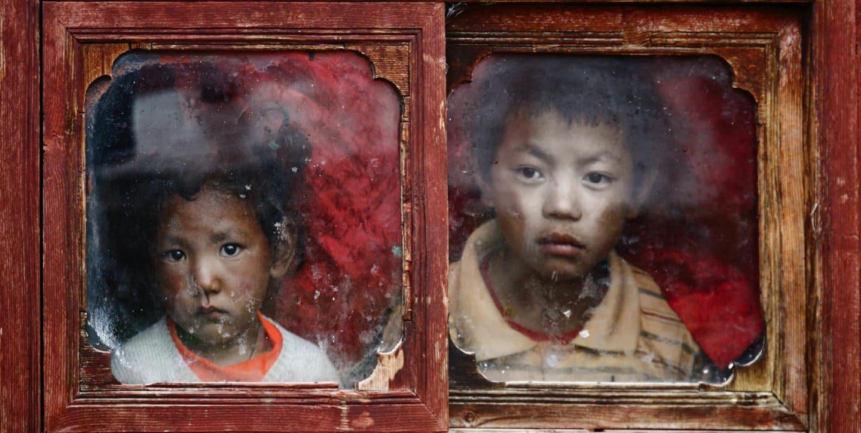 Jean-Claude Louis ©, Boy and Girl in Window, Tagong, Tibet, 2007