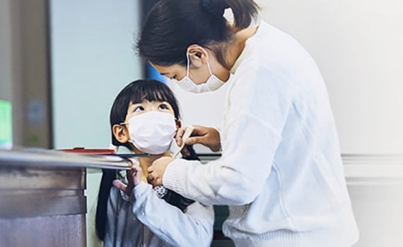 woman and child wearing face masks