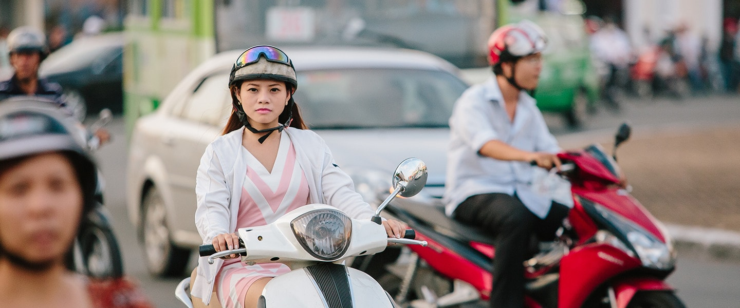woman riding moped