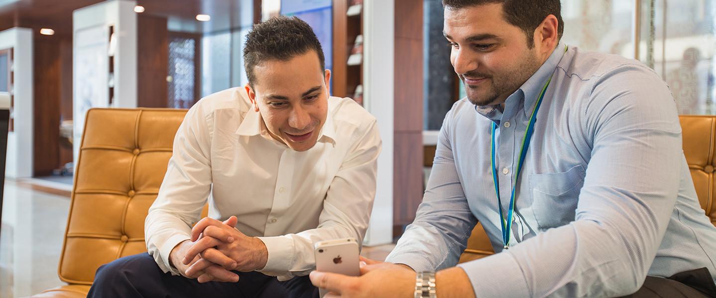 2 men looking at phone