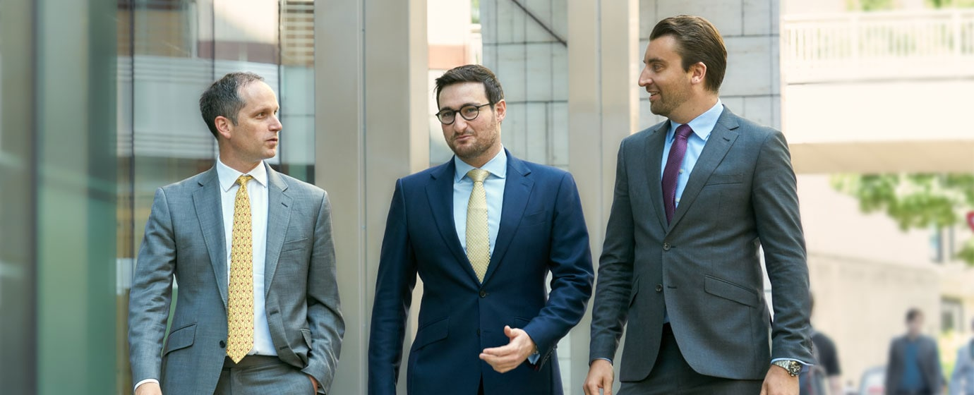 Three business men walking down the street