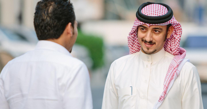 Two men talking about Islamic banking