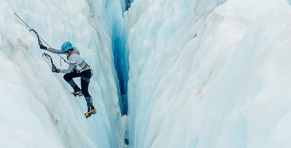 Vertical climber on an ice mountain