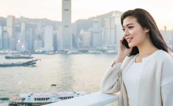 woman talking on phone outside
