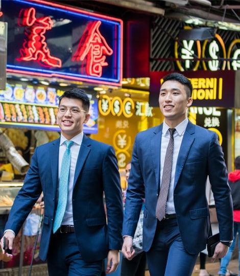 2 men walking along street