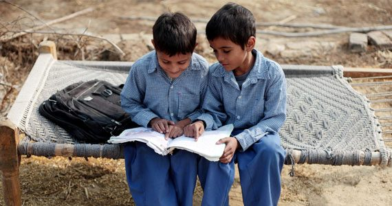Two Indian schoolboys with book