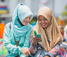 Two women looking at image on phone
