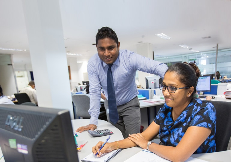 people working together at computer