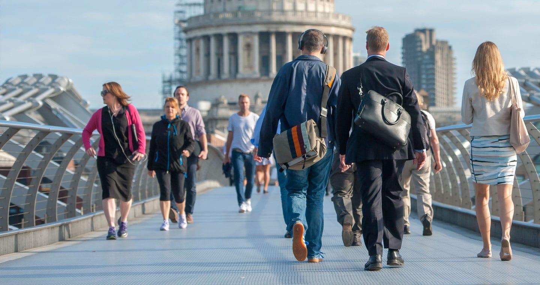 London commuters crossing bridge
