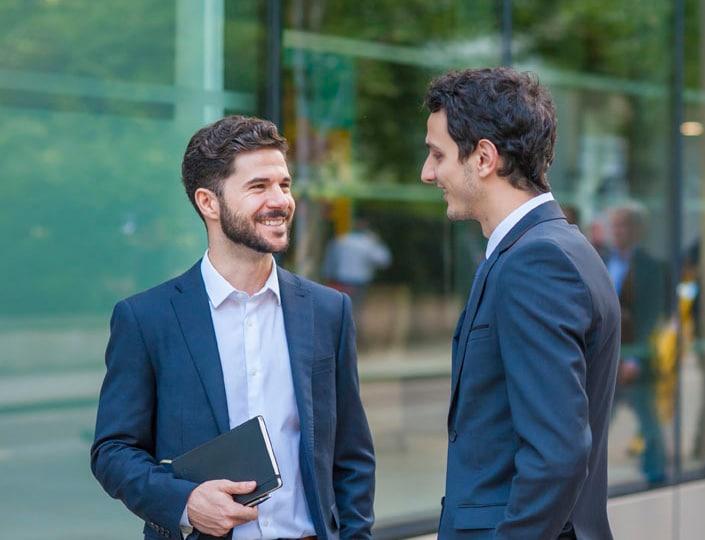 2 men talking outside