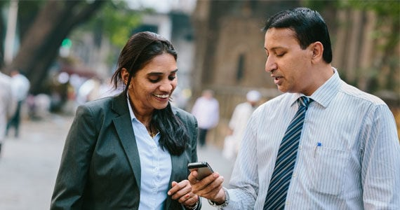 Couple using Straight2Bank wallet
