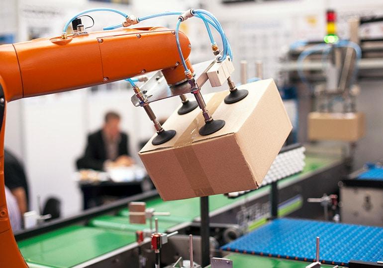 robot moving cardboard box