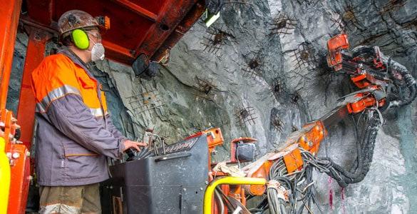 Man operating mining machine