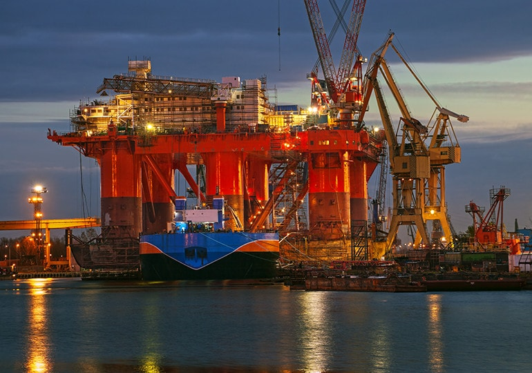 oil rig lit up at night