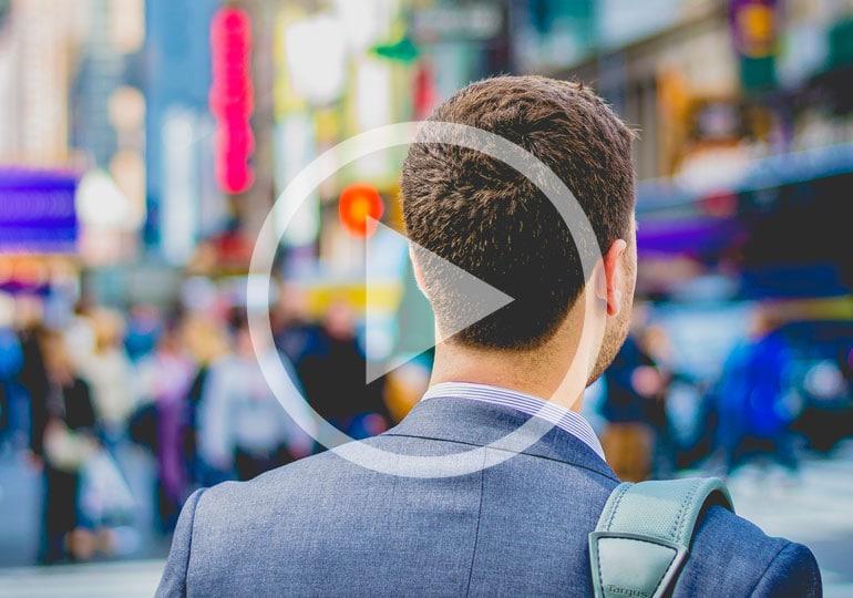 man walking along busy street