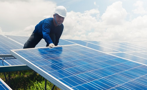 Man adjusting solar panels