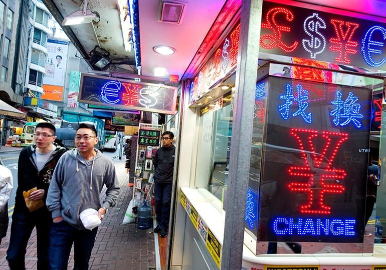 people outside currency exchange shop