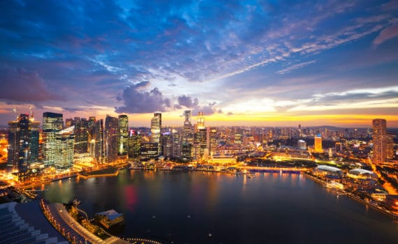 Aerial view of Marina Bay Skyline in Singapore at sunset.