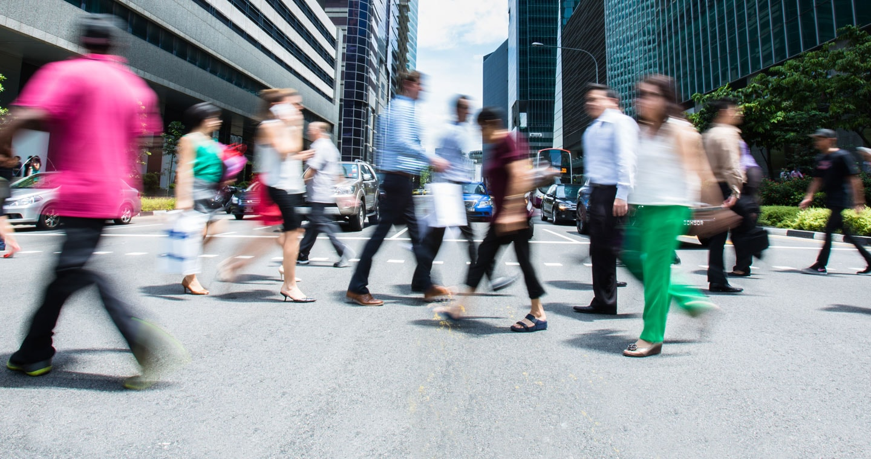 Busy people crossing street