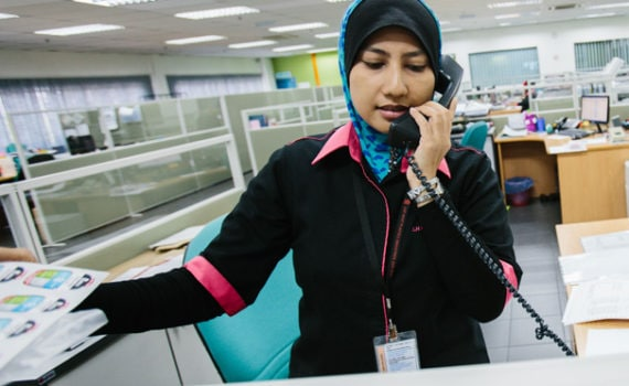 Lady on phone speaking to suppliers