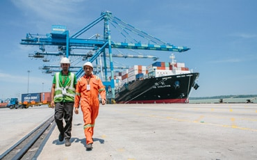 Supporting sustainable economic growth men in port