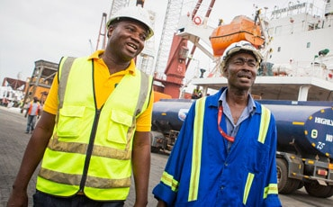 Two workers supported by Standard Chartered's sustainable economic growth framework