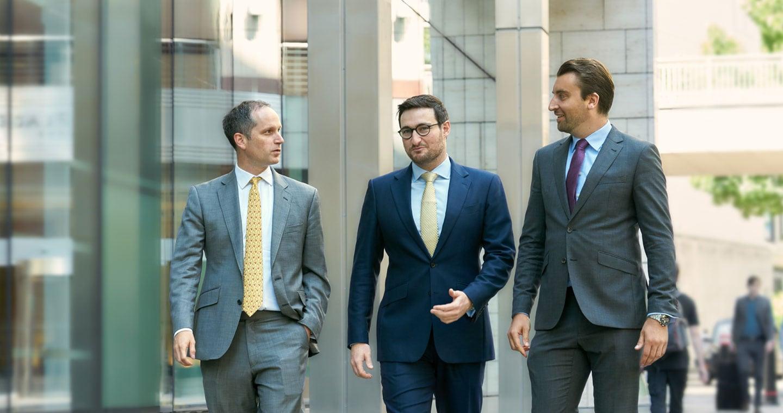 Three shareholders walking down the street