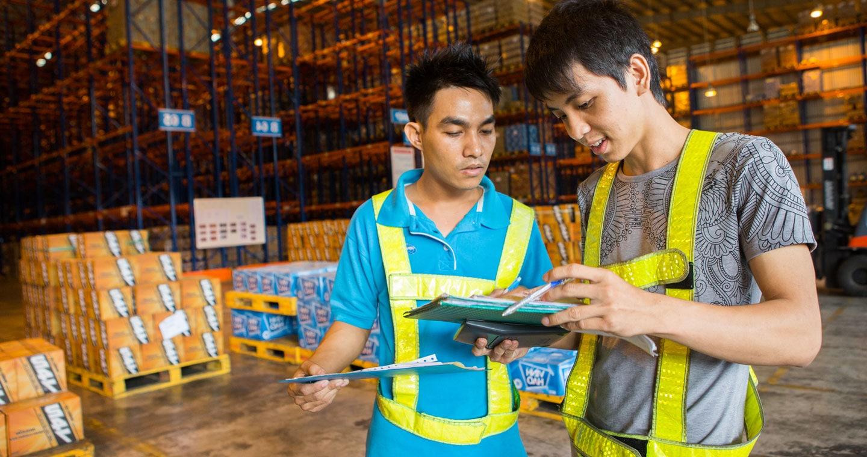 Men in goods warehouse