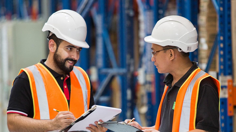 workers having conversation in warehouse