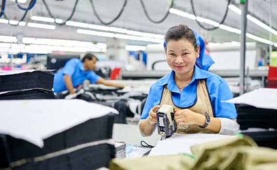 Woman smiling working in factory