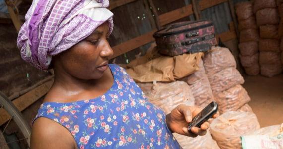 Woman in storage room using phone