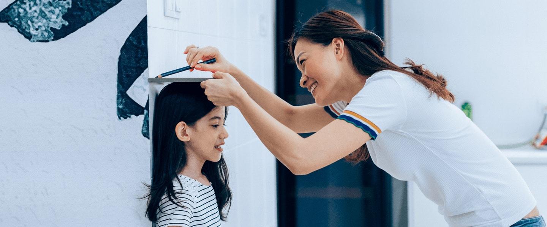 Girl getting height measured