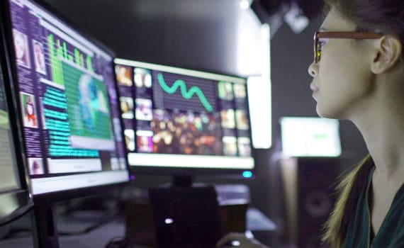 Man looking at computer monitoring for cyber security threats