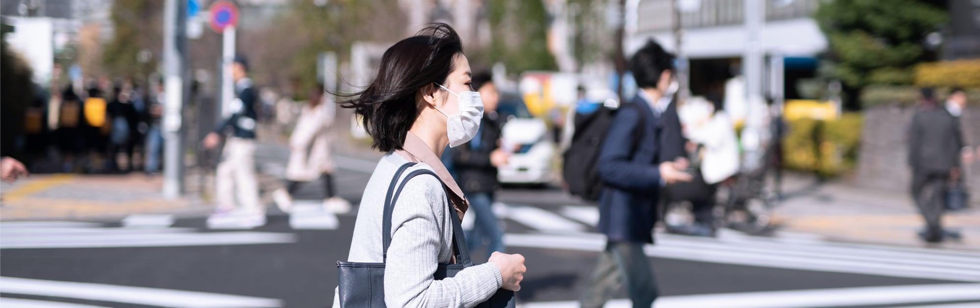 woman wearing mask walking