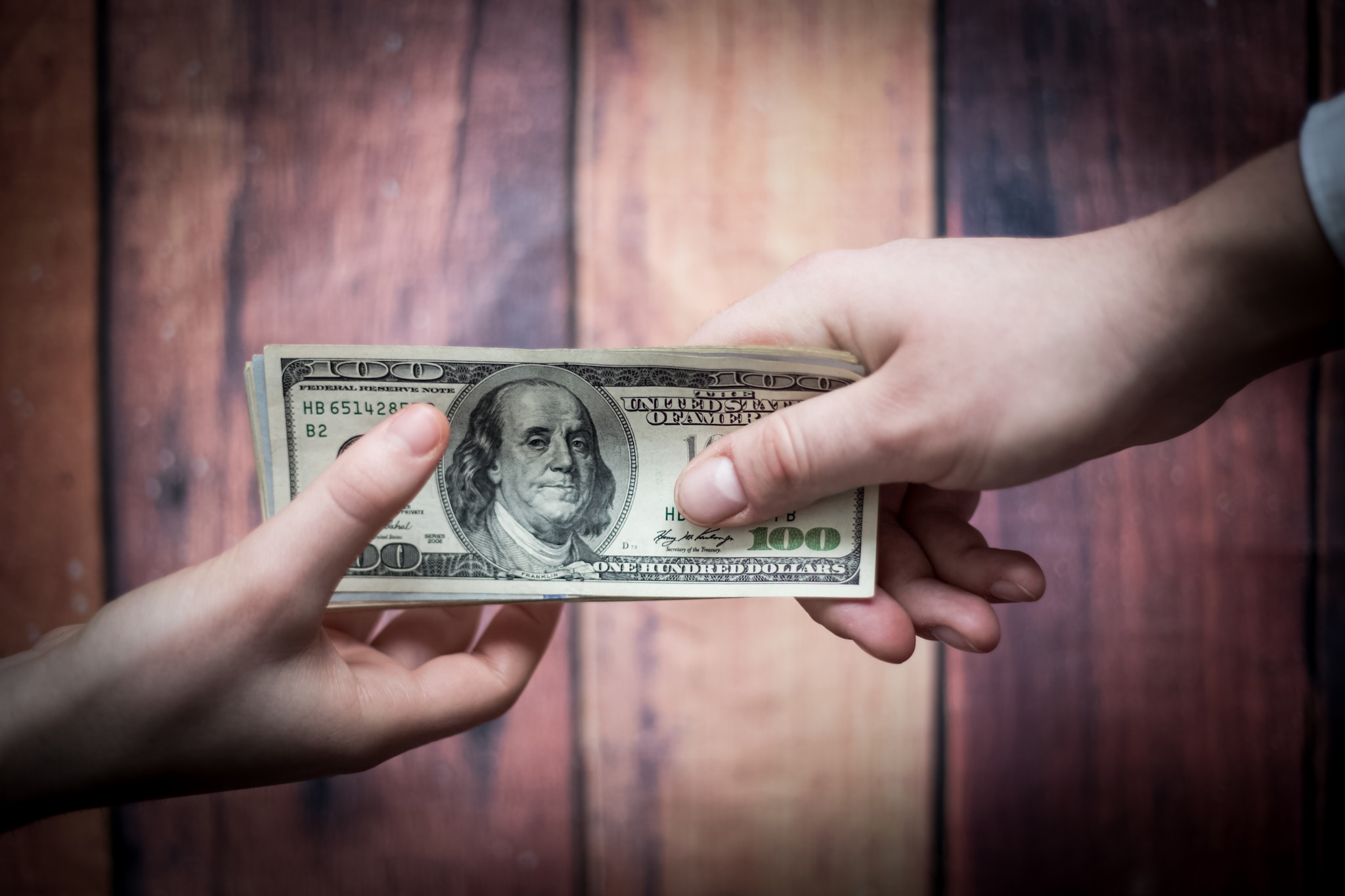 taking money 100 dollar bills