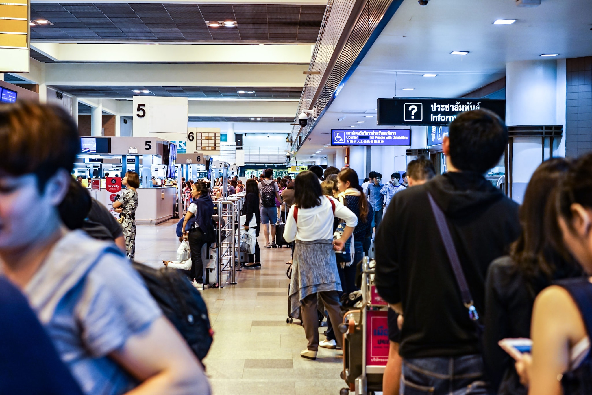 Travellers and passengers in the line are waiting for check in at Donmuang International Airport, Bangkok, Thailand