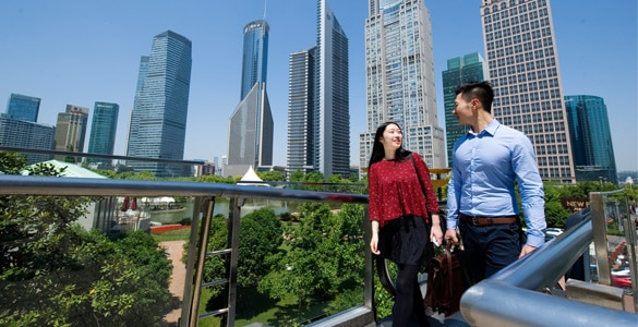 Two wealth management clients walking in Shanghai