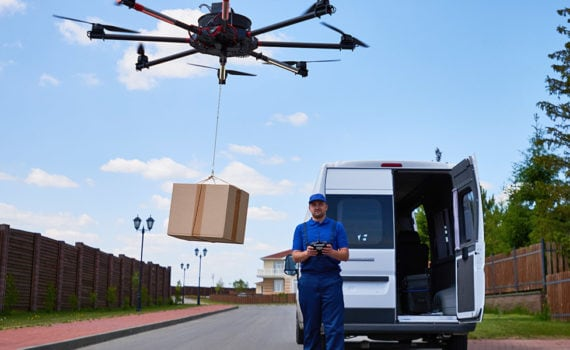 Image of package being delivered by a drone