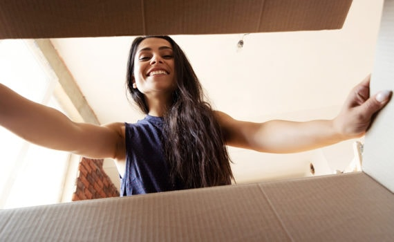 Image of woman opening a box