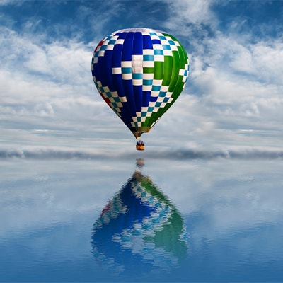Gh travel hotair balloon sea calm peacful reflection scaled fixed deposit x y