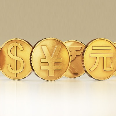4 coins with symbol of Dollar, Japanese Yen, Indian Rupee, and Chinese Yuen