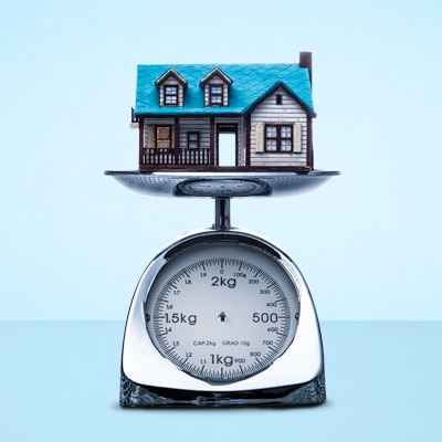a blue house on the metal weight meter