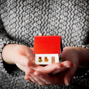 Px photo id woman holding a small new house in her hands real estate mortgage housing concepts etc