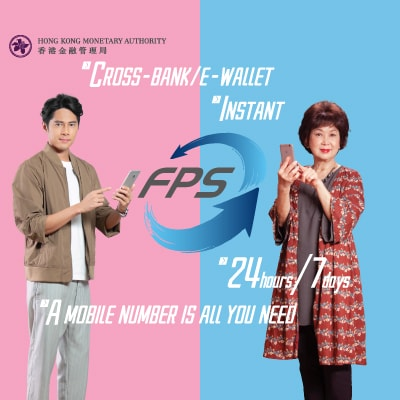Mr Chui Tien You and Miss Mimi Choo using mobile phone for FPS payments