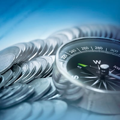 Compass leading to the right investment direction by Standard Chartered with coins