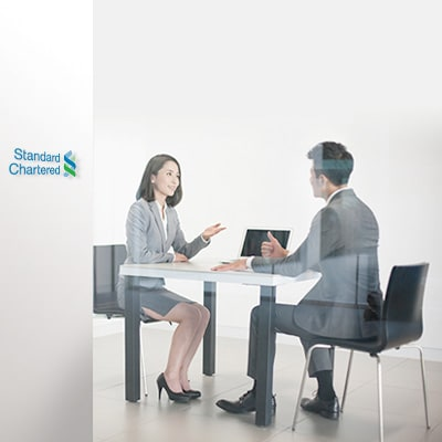 a standard chartered relationship manager is discussing with client regarding retirement products