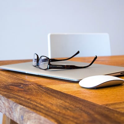 A glasses with laptop and mouse